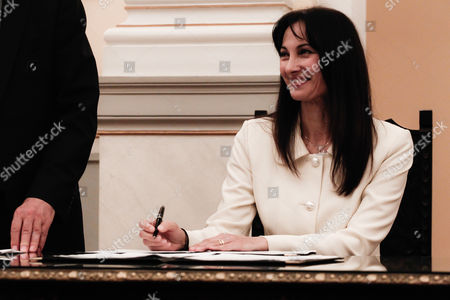Elena Kountoura, vice Minister of Tourism, signs in during a swearing-in ceremony at the Presidential Palace in Athens