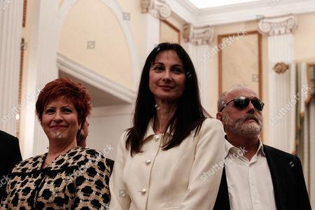 Maria Kollia Tsaroucha, Elena Kountoura, and Panagiotis Kouroumplis take religious oath during a swearing-in ceremony at the Presidential Palace in Athens