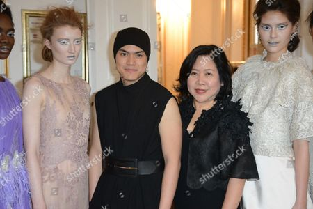 Stock Picture of Busardi Muntarbhorn and Tuck Muntarbhorn with models