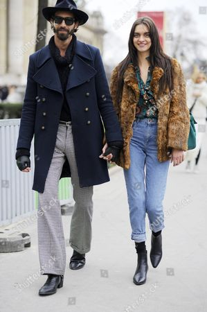 Stock Photo of Model Magda laguinge with boyfriend, PFW FW15 couture, after Chanel, Paris Street Style Fashion.