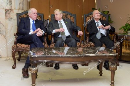 CIA Director John O. Brennan and former National Security Advisers Sandy Berger and Brent Scowcroft chat at King Khaled International Airport