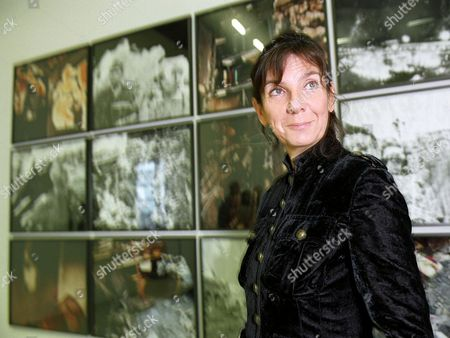 Sophie Calle with pictures from burnt negatives