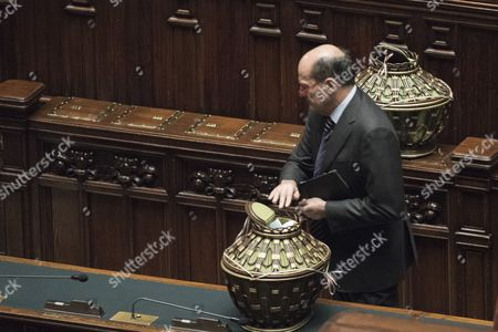 Pier Luigi Bersani of the Democratic Party (PD) casts his ballot