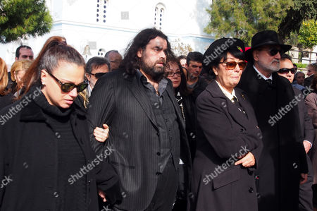 Cyril Roussos, the son of Demis (2nd L) with friends and family
