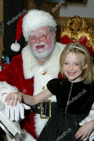 Dom DeLuise (as Santa) and Dakota Fanning
