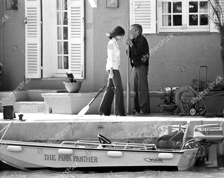 PETER SELLERS AND WIFE LYNNE FREDERICK AT HER HOUSE IN ST TROPEZ, FRANCE WITH THEIR BOAT THE PINK PANTHER - 1980s
