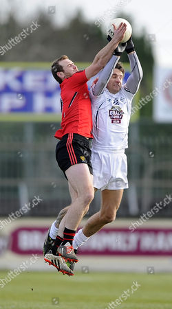 KildareÕs Gary White and Peter Fitzpatrick of Down