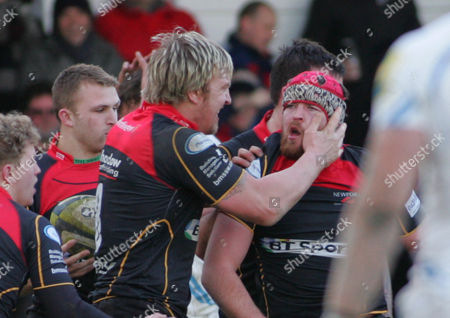 Scott Matthews of Newport Gwent Dragons is congratulated by team mates