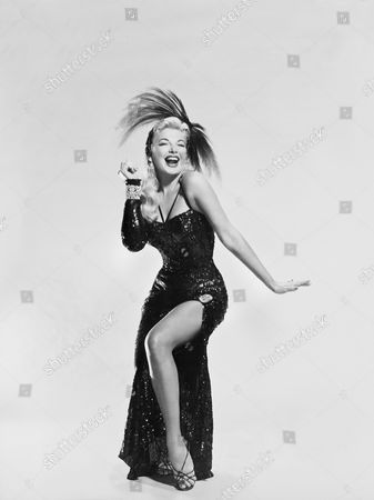 Hollywood, California: 1956 Actress Barbara Nichols plays an innocent stripper in the film, 'Miracle In The Rain'.