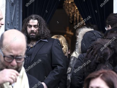 Demis Roussos' son Kyrilos exits the church in the funeral procession for singer Demis Roussos, in Athens