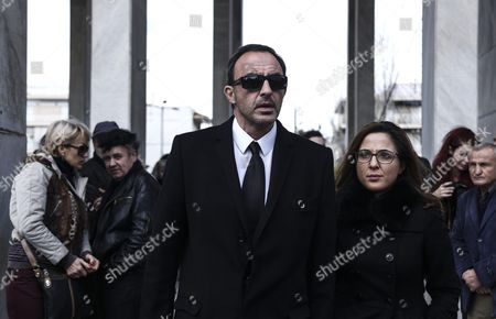 TV host and journalist Nikos Aliagas walks in the funeral procession for singer Demis Roussos, in Athens