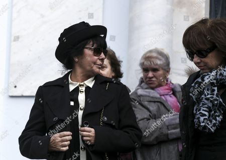 Demis Roussos' wife Anne Marie exits the church in the funeral procession for singer Demis Roussos, in Athens