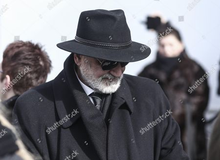 Demis Roussos' brother Costas exits the church in the funeral procession for singer Demis Roussos, in Athens