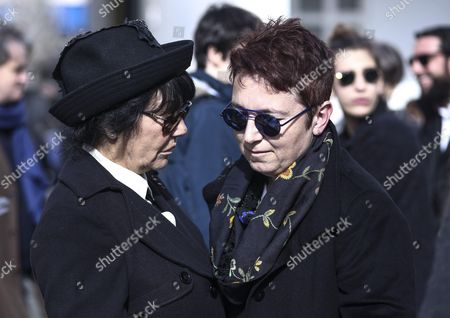 Demis Roussos' wife Anne Marie, left,  talks to a friend outside the church in the funeral procession for singer Demis Roussos, in Athens