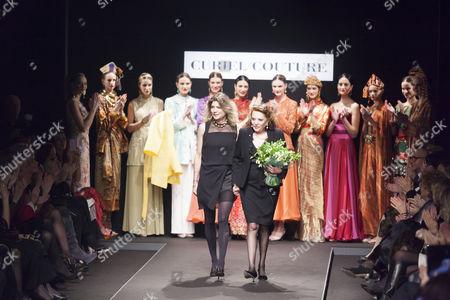 Raffaella Curiel and models on the catwalk