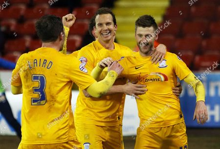 Paul Gallagher of Preston North End celebrates scoring his goal from the penalty spot to make it  1-3 with Kevin Davies
