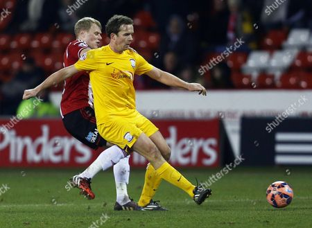 Kevin Davies of Preston North End and James McEveley of Sheffield United