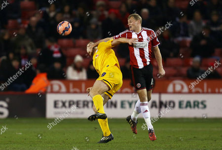 James McEveley of Sheffield United and Kevin Davies of Preston North End