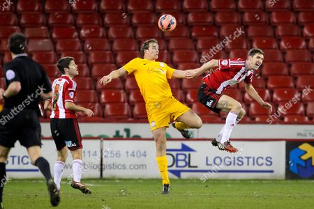 Kevin Davies of Preston North End wins a header