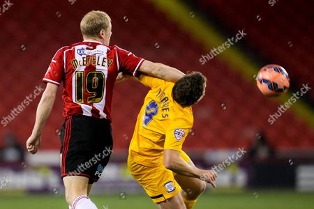 James McEveley of Sheffield United challenges Kevin Davies of Preston North End