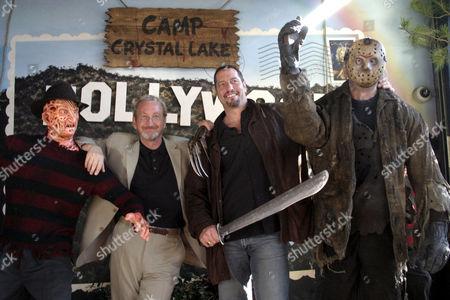 Robert Englund and Ken Kirzinger with 'Freddy and 'Jason' waxwork figures