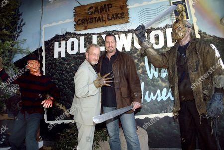 Robert Englund with Ken Kirzinger and 'Freddy' and 'Jason' waxwork figures