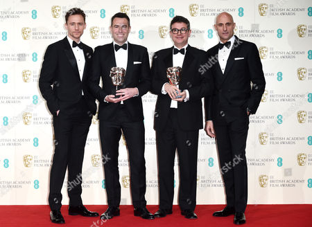 Stephen Beresford and David Livingstone (c) of Pride, winner of 'Outstanding debut by a British writer director or producer' with Tom Hiddleston and Mark Strong