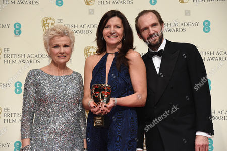 Stock Image of Christine Langan (C) accepts award for Outstanding British Contribution to Cinema won by BBC Films, with Julie Walters and Ralph Fiennes