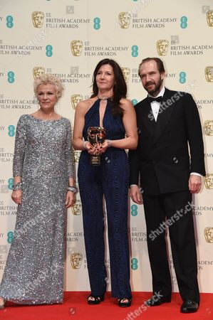 Christine Langan (C) accepts award for Outstanding British Contribution to Cinema won by BBC Films, with Julie Walters and Ralph Fiennes