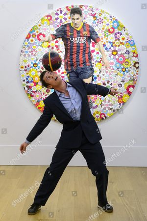 John Farnworth, World Champion Football Freestyler with a painting titled Lionel Messi and a Universe of Flowers (2014) by artist Takashi Murakami with an estimate of £200,000-300,000
