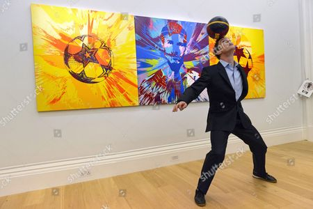 John Farnworth, World Champion Football Freestyler with a painting titled Beautiful Messi Spin Painting for One in Eleven (2014) by artist Damien Hirst with an estimate of £250,000-350,000