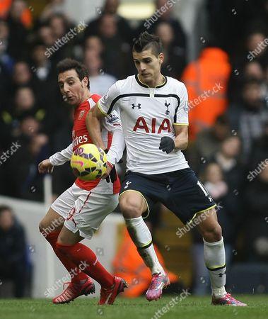 Erik Lamela of Tottenham Hotspur battles with Santi Cazorla of Arsenal