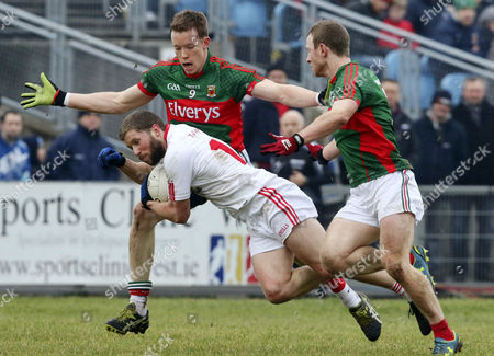 Tyrone's Peter Hughes with Donal Vaughan and Colm Boyle of Mayo