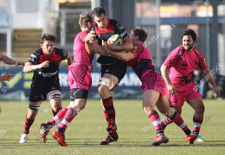 Stock Photo of Dragons Nick Crosswell is held by Seb Jewell and Nick Scott of London Welsh