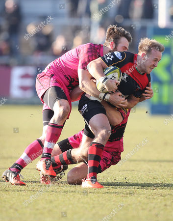 Stock Image of Dragons Ashley Smith is tackled by Nic Reynolds and Seb Jewell of London Welsh