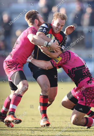 Dragons Ashley Smith is tackled by Nic Reynolds and Seb Jewell of London Welsh