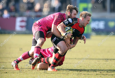 Stock Picture of Dragons Ashley Smith is tackled by Nic Reynolds and Seb Jewell of London Welsh