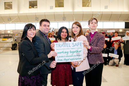 Rev'd Libby Lane poses for pictures with Rev'd George Lane, Jasvinder Sanghera and Sameem Ali during the media call