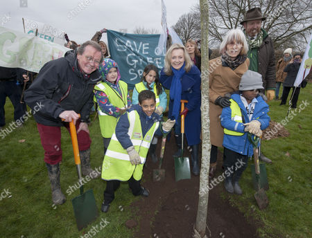 An oak tree, the millionth tree of a £4m government urban tree-planting scheme is planted in Eastville Park in Bristol by Environment Secretary Elizabeth Truss, together with Mayor of Bristol George Ferguson (red trousers) and children from Glenfrome Primary School