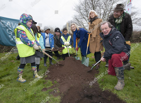 Stock Image of An oak tree, the millionth tree of a £4m government urban tree-planting scheme is planted in Eastville Park in Bristol by Environment Secretary Elizabeth Truss, together with Mayor of Bristol George Ferguson (red trousers) and children from Glenfrome Primary School.