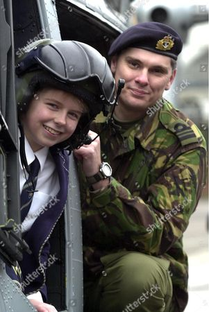 Claire Thomas (11) sits in the cockpit of a Navy Lynx helicopter joined by pilot Lt Commander Graham Cooke (33) who landed in the playground of the school.