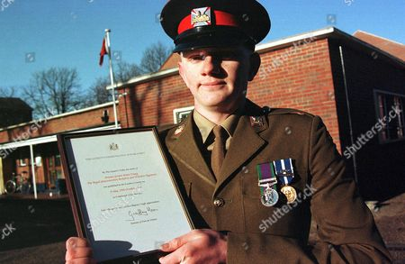 Private Gordon Brian Young with the Queen's Commendation for Bravery, signed by Secretary of State for Defence Geoff Hoon, for his service in Kosovo.