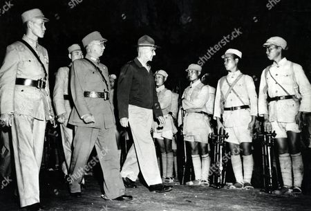 Lieutenant General Joseph W. Stilwell inspecting Chinese troops in India, accompanied on his right by General Sun Li Zen and Lo. The former is the commanding general and the latter deputy chief of staff of the Chinese expeditionary forces. 1942.
