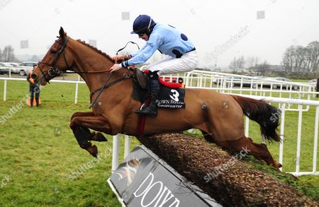 DOWN ROYAL. KEEP ON TRACK and Liam McKenna clears the last fence to win for trainer Ian Ferguson.