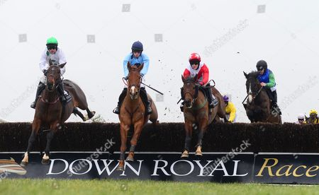 DOWN ROYAL. KEEP ON TRACK and Liam McKenna (2nd left) clears the 1st fence with (L-R) ARAGLEN LAD, GLENANELUCY and HEAVENLY BROOK to win for trainer Ian Ferguson.