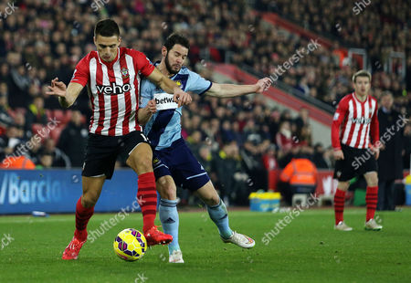 Dusan Tadic of Southampton and Matthew Jarvis of West Ham.