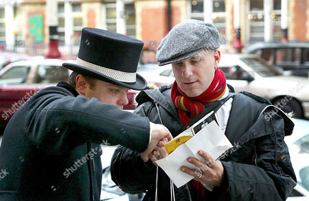 Editorial image of GARY JULES ASKING FOR DIRECTIONS FROM A DOORMAN OUTSIDE THE LANDMARK HOTEL, LONDON, BRITAIN - 03 FEB 2004