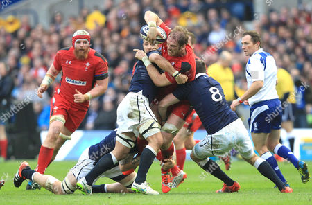 Stock Picture of Wales' Alun Wyn Jones tries to break past Scotland's Johnnie Beattie (R) & Scotland's Blair Cowan (L) 