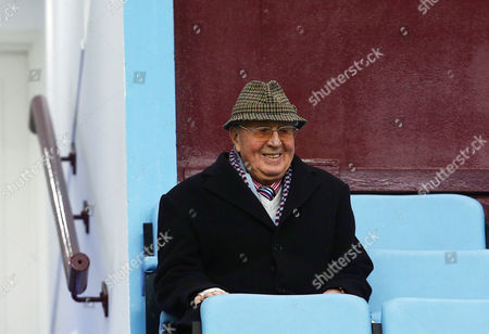 Stock Photo of Sir Doug Ellis looks on from the stand
