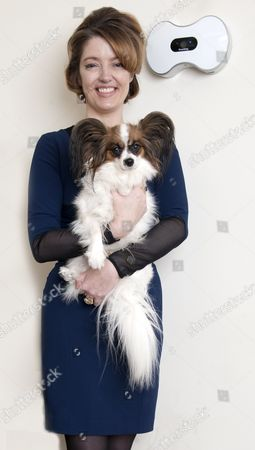 Petronella Wyatt Tries The Smartdog Dog's Treats Dispenser At Home In London With Her Dog 'mini'